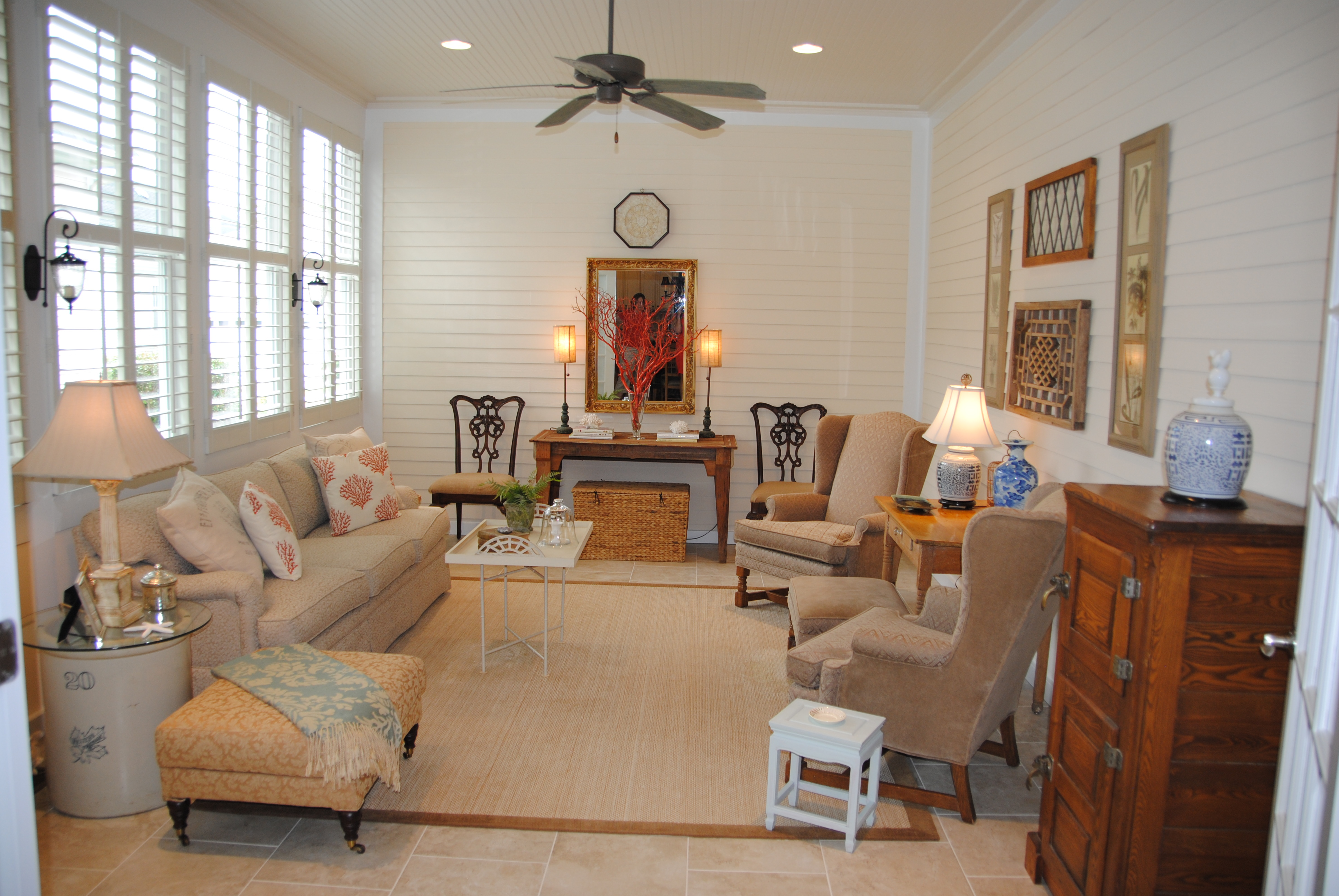 In november we added plantation shutters and i furnished with a sofa - I Put Neutral Travertine Like Tile On The Floor Painted The Walls A Soft Cream And Kept The Plantation Shutters From Before I Asked The Contractor To